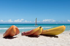 Kayaks on ocean beach Royalty Free Stock Photos