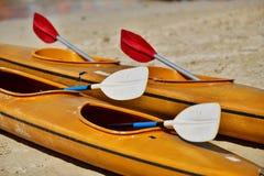 Kayaks and paddles Stock Photos