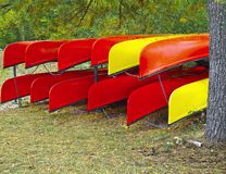 Kayaks rack on shore Stock Image