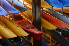 Kayaks in Racks. A rack full of kayaks waiting to be used stock photo