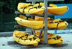 Kayaks For Rent. Photographed at a local campground in Florida Royalty Free Stock Photo