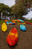 Kayaks rental. Kayaks on the pebbles shore & banks with trees on the background Royalty Free Stock Photos