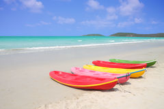 Kayaks rest on tropical beach. Royalty Free Stock Photography
