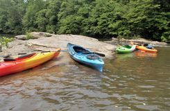 Dan River. Kayaks resting on the rocks in a calm section of the Dan River near Danbury, North Carolina royalty free stock images