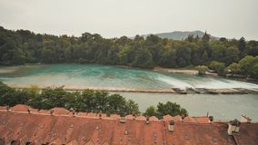 Kayaks on the river Aare. Rafting on the river Aare. Swimmers in Bern.  stock video