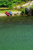 Kayaks on river bank Royalty Free Stock Photo