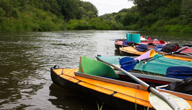 Kayaks. On the river bank in water trips Royalty Free Stock Images