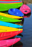 Kayaks in river. Colorful plastic boat Stock Photos