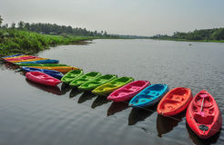 Kayaks in river. Colorful plastic boat Royalty Free Stock Photo