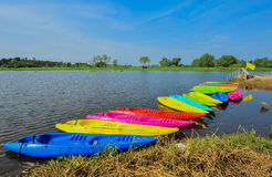 Kayaks in river. Colorful plastic boat Royalty Free Stock Photos