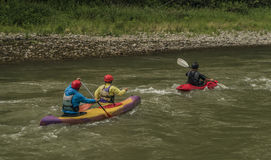 Kayaks on river Dunajec with male Stock Image