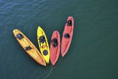 Kayaks in a row. Multi colored kayaks in water near Santa Barbara's Pier in California Stock Photo