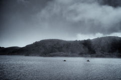 Kayaks in the Russian River. Kayaking in the fog on the Russian River. This image exemplifies peace, quiet and solitude Royalty Free Stock Images