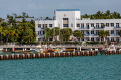 Kayaks and Sailboats at Port Building Stock Image