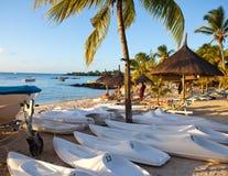 Kayaks on sand on  seashore Stock Photography
