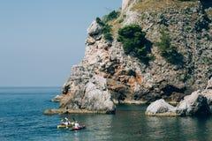 Kayaks at sea. Tourist kayaking in the sea near Dubrovnik, Croat Royalty Free Stock Photography