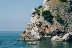 Kayaks at sea. Tourist kayaking in the sea near Dubrovnik, Croat Royalty Free Stock Photos