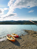 Kayaks in the shore. Two Kayaks in the reservoir of Sant Antoni, Cataluña (SPAIN Royalty Free Stock Photos