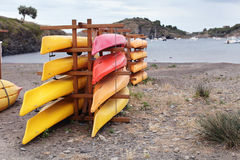 Kayaks stacked on the beach Royalty Free Stock Photos