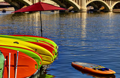Kayaks Stacked on Dock in Water Stock Photos