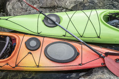 Kayaks stand moored on a rocky seashore. Top view. Stock Images