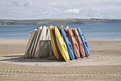 Kayaks stood up on the beach royalty free stock image