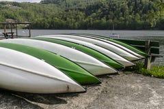 Kayaks on their Sides Stock Photos
