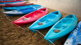 Kayaks of various colors Royalty Free Stock Images