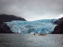 Kayaks Viewing Tidewater Glacier, Kenai Fjords National Park, Alaska royalty free stock photography