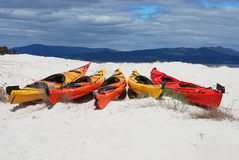 Kayaks on a white sandy beach Royalty Free Stock Image