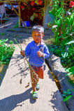 Kayan boy in a long-neck hill village in Thailand. PAI, THAILAND - NOV 23, 2016: Kayan boy in a Long-necked Ban Huay Pa Rai Hill Tribe Village near Pai, Thailand stock images