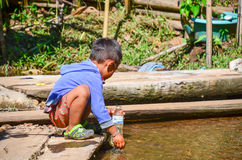 Kayan boy in a long-neck hill village in Thailand. PAI, THAILAND - NOV 23, 2016: Kayan boy in a Long-necked Ban Huay Pa Rai Hill Tribe Village near Pai, Thailand royalty free stock photography
