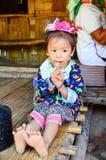 Kayan girl in a long-neck hill village in Thailand. PAI, THAILAND - NOV 23, 2016: Kayan girl in a Long-necked Ban Huay Pa Rai Hill Tribe Village near Pai stock photos