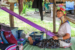 Free Kayan Girl With Loom Royalty Free Stock Photography - 80157307