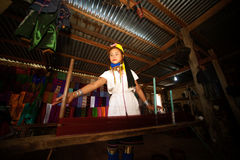A Kayan Lahwi girl is spinning. Royalty Free Stock Images