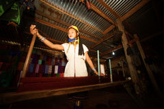 A Kayan Lahwi girl is spinning. Stock Photos