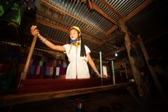 A Kayan Lahwi girl is spinning. Stock Photos