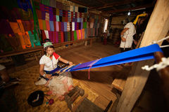Kayan Lahwi girl is weaving. Royalty Free Stock Photos