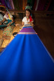 Kayan Lahwi girl is weaving. Stock Images