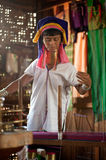 A Kayan Lahwi oldest woman is spinning. Royalty Free Stock Image