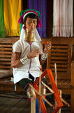 A Kayan Lahwi oldest woman is spinning. Royalty Free Stock Images