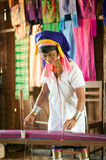 A Kayan Lahwi oldest woman is spinning. Royalty Free Stock Photo