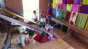 Kayan Lahwi tribe women weaves, Inle Lake. Inle Lake, Myanmar-December 20, 2015. Kayan Lahwi tribe women weaves in handicraft shop of Kayan people on December 20 stock video