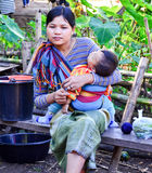 Kayan mother and daughter in Thailand hill village. PAI, THAILAND - NOV 23, 2016: Kayan mother and daughter in the Long-necked Ban Huay Pa Rai Hill Tribe Village stock images