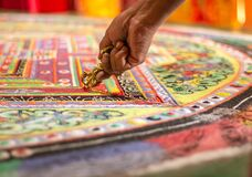A colourful tibetan mandala in a monastery