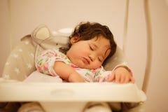 Kazakh baby sleeping in swing. Sweet baby sleeping in swing Stock Images