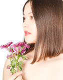 Kazakh  beautiful woman  with pink flowers Royalty Free Stock Photo