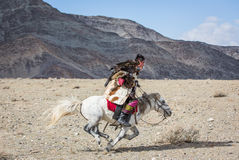 Kazakh eagle hunter on his horse Stock Photography