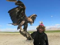 Kazakh eagle hunter. Traditional kazakh eagle hunter on steppe stock image