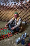 Kazakh family of hunters with golden eagles inside the mongolian Yurt Royalty Free Stock Photography
